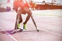 Athlete ready to start relay race. On running track Stock Photos