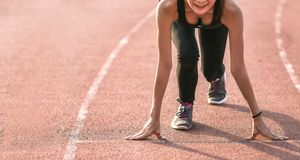 Athlete ready to start on the running track. royalty free stock image