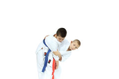 An athlete with a red belt is doing throw Judo Royalty Free Stock Image