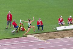 Athlete and referees on triple jump royalty free stock photos