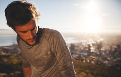 Athlete relaxing after morning run Stock Images