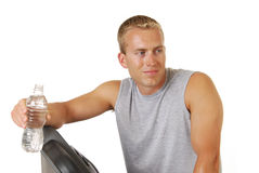 Athlete resting on treadmill Royalty Free Stock Images