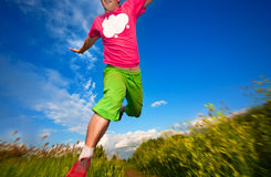 Athlete runing against the blue sky Stock Photos