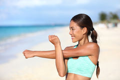 Athlete runner doing fitness warm-up stretching shoulder and arms Royalty Free Stock Photography