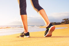 Athlete runner feet on the beach Stock Images