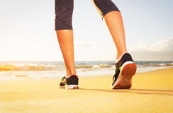 Athlete runner feet on the beach Royalty Free Stock Photo