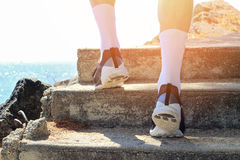 Athlete runner feet running in nature, closeup on shoe. Man fitness running, active lifestyle concept Stock Photo