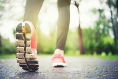 Athlete runner feet running on the road closeup on shoe. Jogger royalty free stock photos