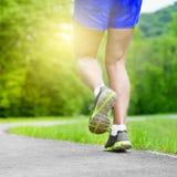 Athlete runner feet running on road Royalty Free Stock Photo