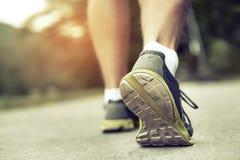 Athlete runner feet running on road Stock Photo