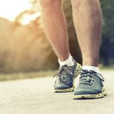 Athlete runner feet running on road Royalty Free Stock Images