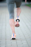 Athlete runner feet running on road closeup on shoe. woman fitne Stock Images