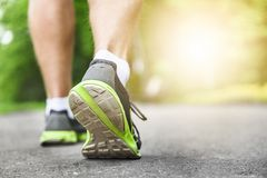 Athlete runner feet running on road Royalty Free Stock Photo
