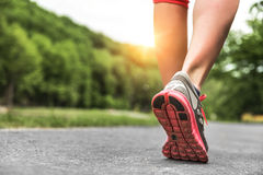 Athlete runner feet running on road Stock Photos