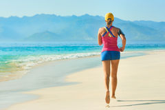 Athlete runner resting after jogging training outdoors in beach. Stock Photos