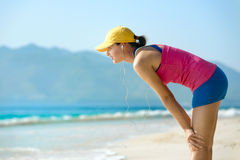Athlete runner resting after jogging training outdoors in beach. Stock Image