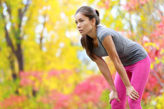 Athlete runner resting after running - Asian woman stock photography