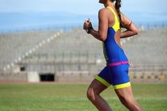 Athlete runner running. On athletic track Stock Image
