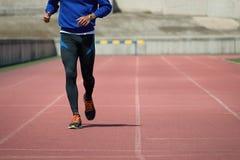 Athlete runner running. On athletic track Stock Photo