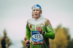 Athlete runner running middle-aged by distance Royalty Free Stock Photography