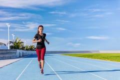 Athlete runner running on outdoor stadium tracks Stock Image