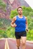 Athlete runner running on road Royalty Free Stock Photos