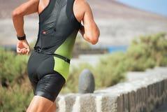 Athlete runner running on triathlon race. On sunny days royalty free stock image