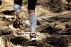 Athlete runner runs rocks in mountain Royalty Free Stock Photo