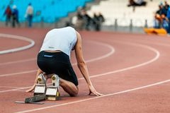 Athlete runner in starting blocks Stock Images
