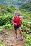Athlete runner trail running on mountain nature Stock Photos