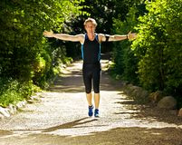 Athlete Running with Arms Outstretched Royalty Free Stock Photography
