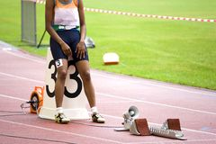Athlete by running blocks Stock Images