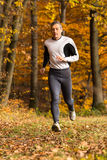 Athlete  running in the forest in autumn Royalty Free Stock Photography
