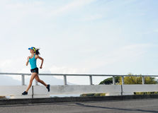 Athlete running outdoors Royalty Free Stock Image