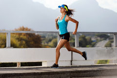 Athlete running outdoors Stock Image
