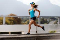 Athlete running outdoors Stock Image