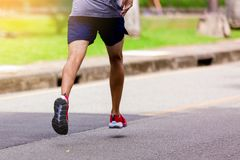 Athlete running at park outdoor in the morning. royalty free stock photo