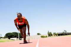 Athlete running on the racing track Stock Photo