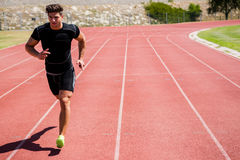 Athlete running on the racing track Royalty Free Stock Photos