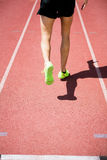Athlete running on the racing track Royalty Free Stock Image