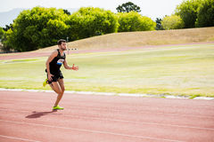 Athlete running on the racing track Stock Image