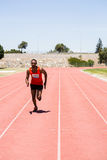 Athlete running on the racing track. On a sunny day Stock Photo