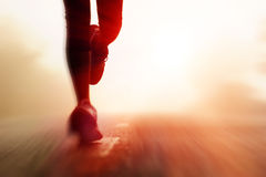 Athlete running road silhouette. Runner athlete feet running on road. woman fitness silhouette sunrise jog workout wellness concept. with motion blur stock images