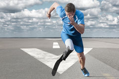 Athlete running runway. Disabled athlete with explosive start on the runway stock image
