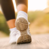 Athlete running sport feet in nature healthy lifestyle fitness Stock Image