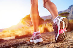 Trail running woman. Athlete running sport feet on trail healthy lifestyle fitness Royalty Free Stock Photo