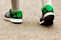 Athlete running sport shoes on trail healthy lifestyle Stock Image