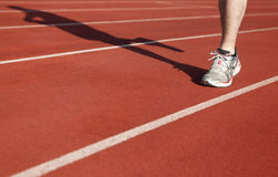 Athlete running on sports area Royalty Free Stock Images