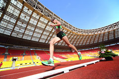 Athlete running in the stadium Stock Images