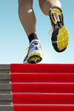 Athlete running stairs Royalty Free Stock Photos